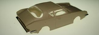 Atlas HO Slot Car Tan Studebaker Avanti Rear Bumper