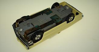 Atlas HO Slot Car Yellow Pontiac Grand Prix Posts